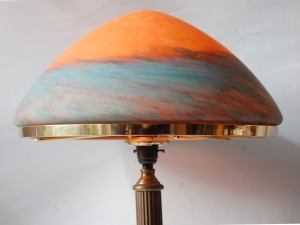 The Trafalgar table lamp in antique finish with marble effect glass shade
