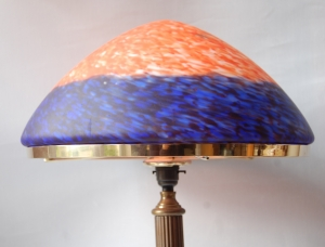 The Trafalgar table lamp in antique finish with blue marble effect glass shade